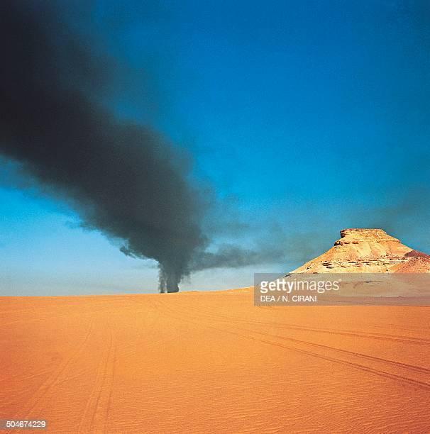Methane fumes Zelten oil field Sahara Desert Libya
