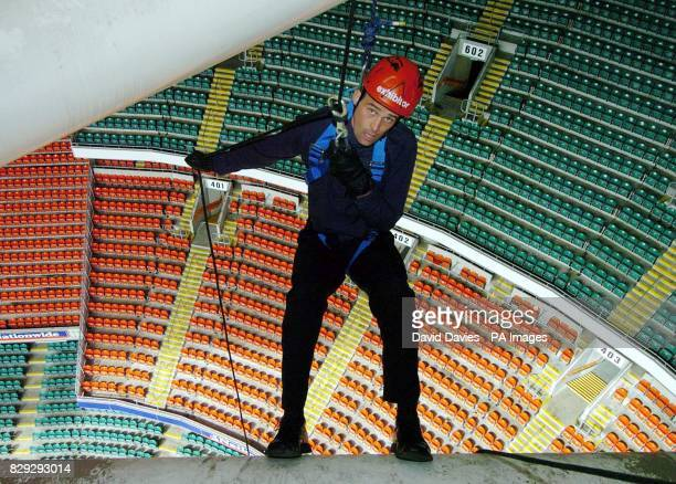 Methodist minister Rev Andrew Webster about to descend from the roof of the Millennium Stadium in Cardiff A 'vertigo vicar' conquered his lifelong...
