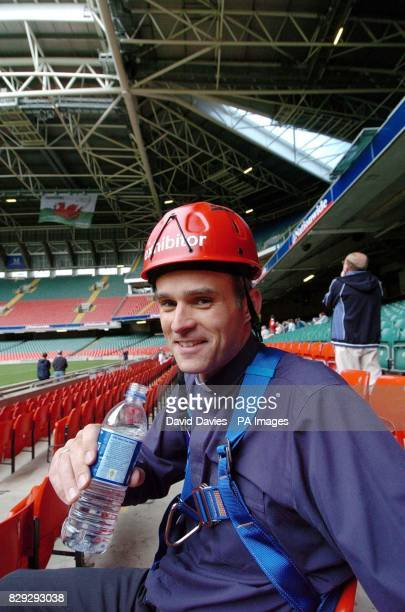 Methodist minister Rev Andrew Webster after his abseil from the roof of the Millennium Stadium in Cardiff A 'vertigo vicar' conquered his lifelong...