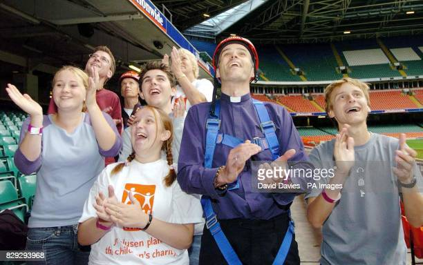 Methodist minister Rev Andrew Webster looks up at the roof of the Millennium Stadium with parishioners A 'vertigo vicar' conquered his lifelong fear...