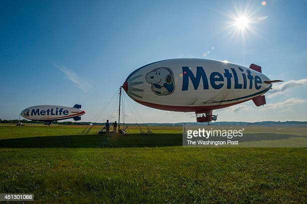 MetLife blimps Snoopy 1 and Snoopy 2 prepare to take off from Frederick Airport June 26 2014 in Frederick MD One will fly around the Frederick area...