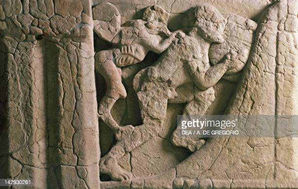 Metope depicting the punishment of Sisyphus pushing the boulder hampered by a winged demon relief of the ancient thesaurus of Heraion at the mouth of...