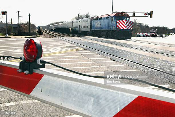 Metra commuter train passes through a Union Pacific maintained railroad crossing on March 29 2004 in the Chicago suburb of Des Plaines Illinois US...