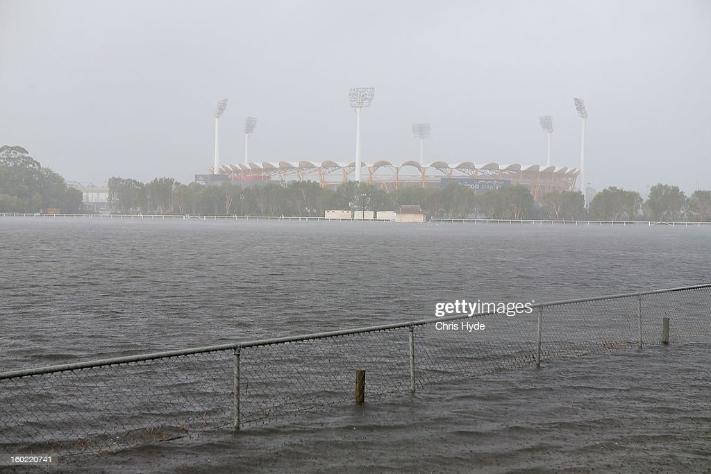 Metricon staium carpark floods as Queensland experiences severe rains and flooding from Tropical Cyclone Oswald on January 28, 2013 in Gold Coast, Australia. Hundreds have been evacuated from the towns of Gladstone and Bunderberg while the rest of Queensland braces for more flooding.