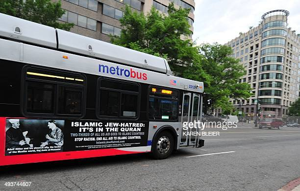 A Metro bus featuring a controversial ad drives on a street in Washington DC on May 21 2014 Busads linking 'Islamic Jewhatred' Islam with Adolf...