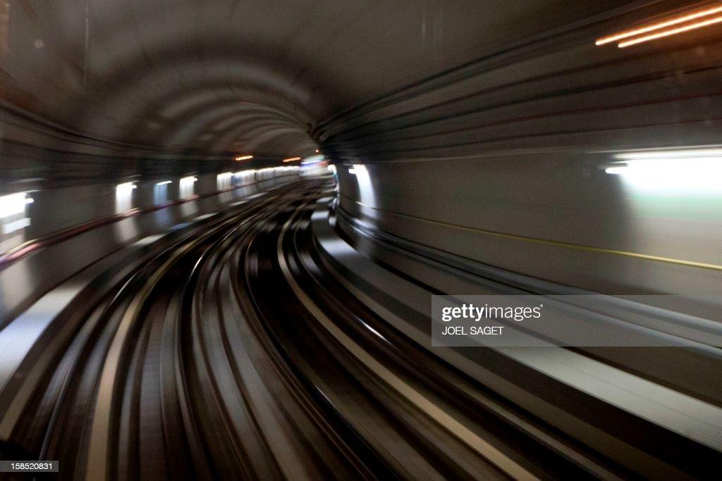 A metro drives through a tunnel on December 18, 2012 in Paris.