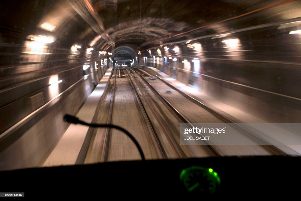 A metro drives through a tunnel on December 18, 2012 in Paris.