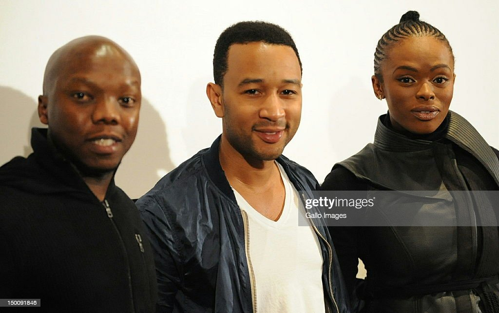 Metro FM DJ T-Bo Touch with singer John Legend and Unathi Msengana attend a press conference on August 9, 2012 in Johannesburg, South Africa. The nine-time Grammy Award winneris due to perform a special Women's Month one-night show.