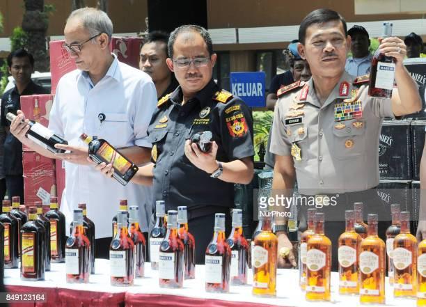 Metro Jaya Police Chief Inspector General of Police Idham Azis along with Director General of Customs Heru Pambudi showed evidence of alcohol...