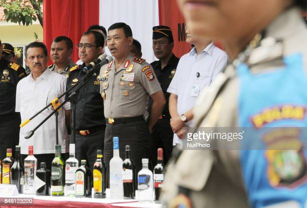 Metro Jaya Police Chief Inspector General of Police Idham Azis showed evidence of alcohol smuggling case Jakarta Indonesia on September 18 2017...