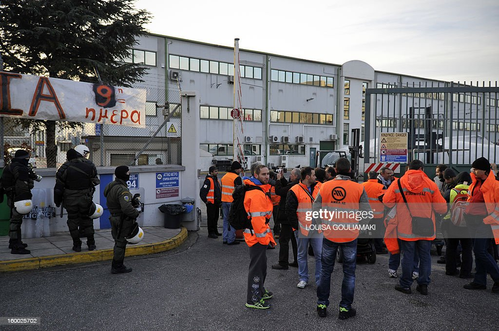 Metro on-strike workers gather outside Athens main depot on January 25, 2013, after police broke out their sit-in on January 25, 2013. The raid on the centre, which strikers protesting austerity measures had occupied took place overnight. The government had ordered a civil mobilisation the day before to force the Athens metro staff to halt their strike, which has disrupted traffic in the Greek capital for over a week. Unions reacted by calling a general transport standstill today.