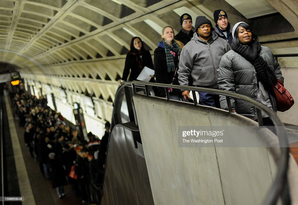 Metro riders make their way up the escalator of the Judiciary Square Metro on their way to the second term inauguration of President Barack Obama. January, 21, 2013 in Washington, DC.