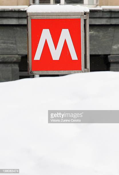 A metro sign is covered by snow on February 2 2012 in Milan Italy The cold front sweeping over the country has affected regions from Piedmont to...