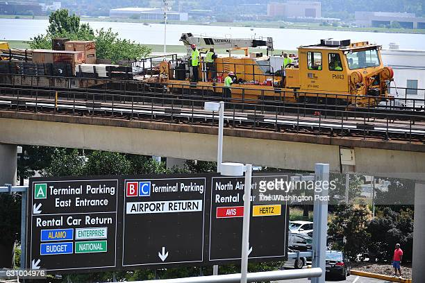 Metro starts stage 3 with construction workers repairing tracks outside the Reagan National Airport in Arlington Virginia on July 06 2016 Metro...