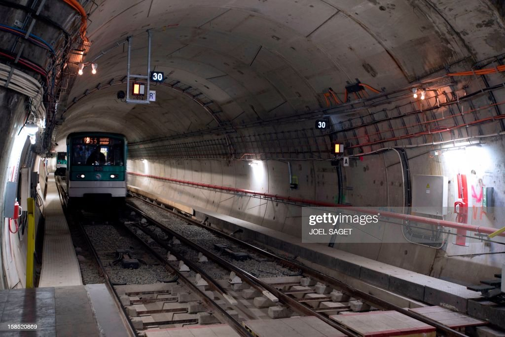 A metro train arrives at the Front Populaire subway station on its inauguration day on December 18, 2012 in Aubervilliers-Saint-Denis, north of Paris.