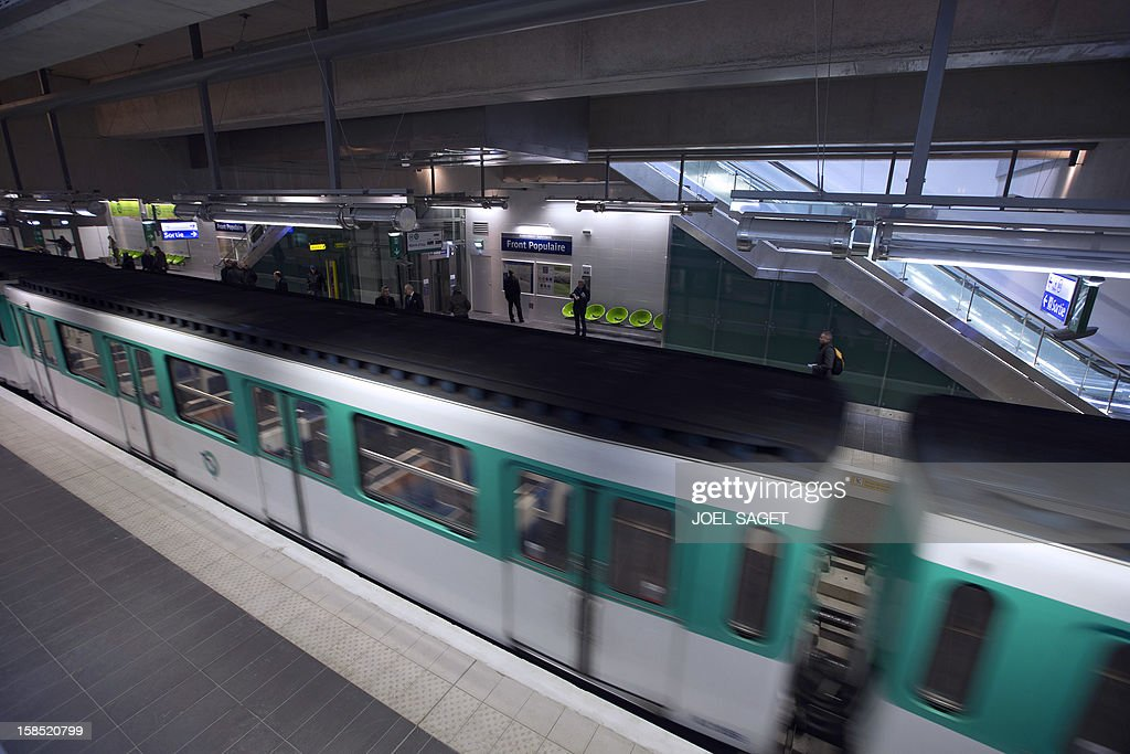 A metro train leaves the Front Populaire subway station on its inauguration day on December 18, 2012 in Aubervilliers-Saint-Denis, north of Paris. AFP PHOTO / JOEL SAGET