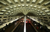 Metro trains arrive at the Gallery Pl Chinatown Station October 27 2010 in Washington DC Farooque Ahmed a naturalized US citizen originally from...