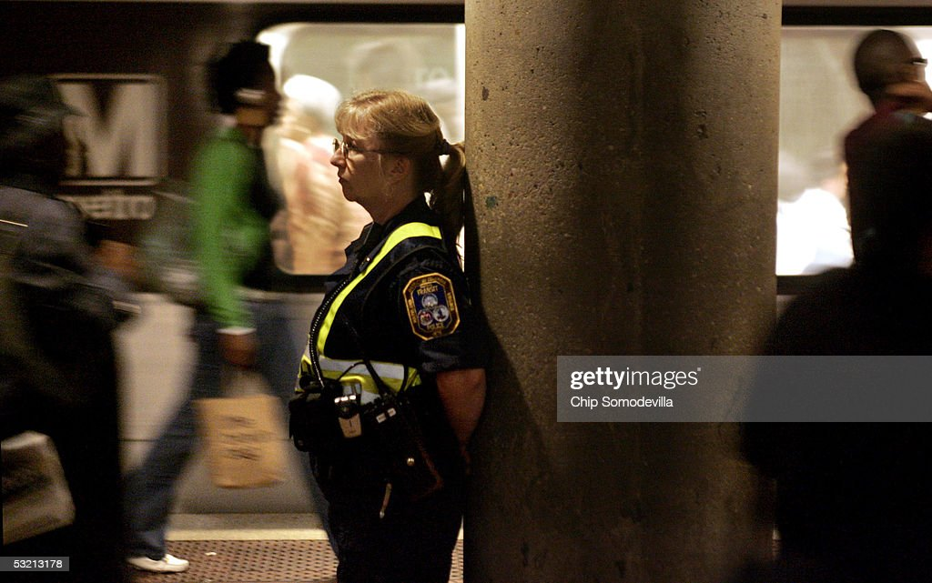 Metro Transit Authority Police Officer K. Watson keeps an eye on the morning rush hour passengers at the Metro Center subway stop July 8, 2005 in downtown Washington, DC. Security on and around the DC Metro subway trains and buses was increased in the wake of explosions that killed at least 50 people and injured hundreds of others on London's mass transit system on July 7th. In the wake of the London attacks, the U.S. Department of Homeland Security raised the threat level to high, or code 'orange,' for mass transportation systems in the United States.