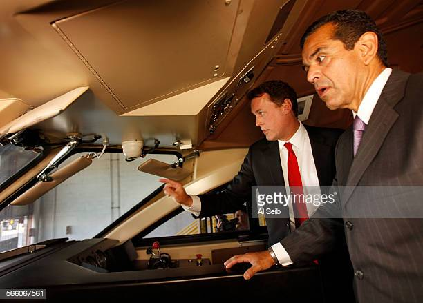 Metrolink Board Chairman Keith Millhouse left shows Los Angeles Mayor Antonio Villaraigosa the two inward–facing cameras and one outward–facing...
