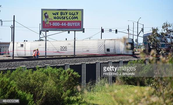 A Metrolink train carriage is seen turned on its side after a truck was hit by the Los Angelesbound Metrolink train during the early morning commute...