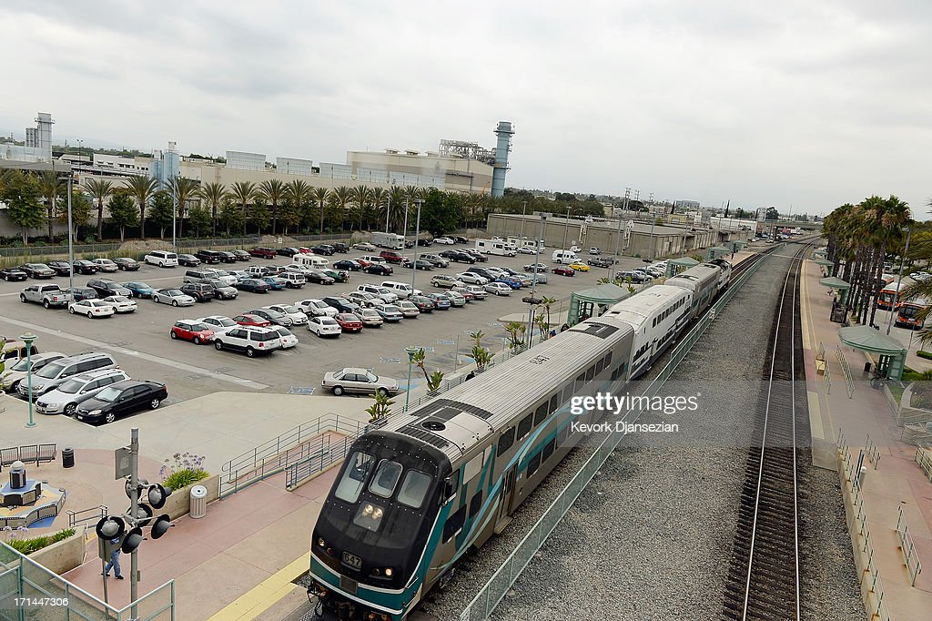 Metrolink train stops to pick up passengers at a train station next to the Burbank Water and Power natural gasfueled power plant on June 24 2013 in...