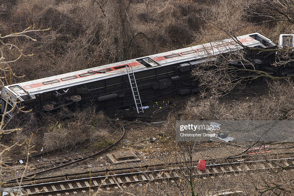 MetroNorth commuter train lies in the brush after it derailed just north of the Spuyten Duyvil station December 1 2013 in the Bronx borough of New...