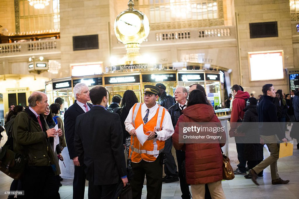 A Metro-North employee helps people in Grand Central Terminal after Metro-North commuter train service was disrupted following a building collapse in the East Harlem neighborhood blew debris over the tracks March 12, 2014 in New York City. Service was restored just before the evening rush with limited service on the Harlem and New Haven Lines. Hudson Line customers need to use the subway and transfer to 153rd st in the Bronx. Reports of an explosion were heard before the collapse of two multiple-dwelling buildings at East 116th St. and Park Avenue that left at least 2 dead anda number of people are injured and missing.