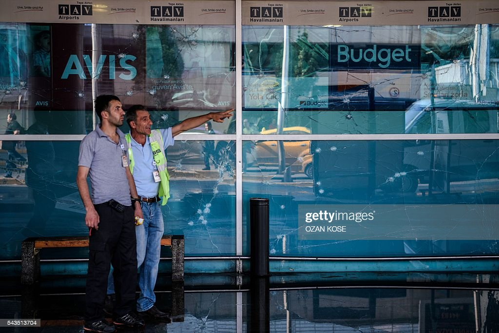 Metropolitan municipality employees work outside Ataturk airport's international arrivals terminal on June 29, 2016, a day after a suicide bombing and gun attack targeted Istanbul's airport, killing at least 36 people. A triple suicide bombing and gun attack that occurred on June 28, 2016 at Istanbul's Ataturk airport has killed at least 36 people, including foreigners, with Turkey's prime minister saying early signs pointed to an assault by the Islamic State group. / AFP / OZAN
