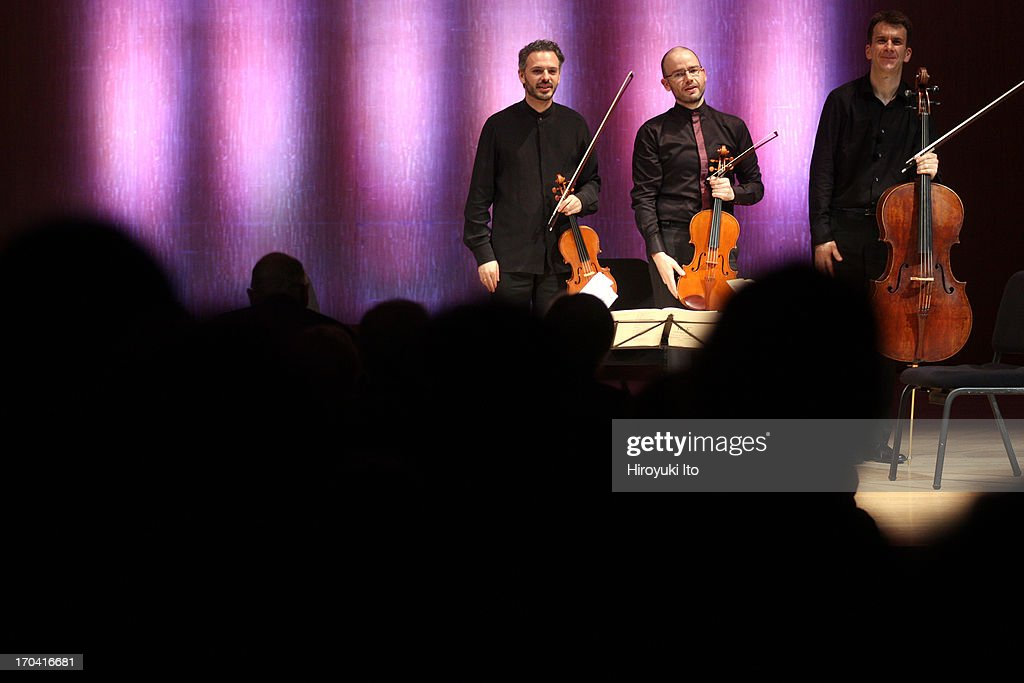 Metropolitan Museum Artists in Concert performing their final concert after 10 years of artist-in-residence at the Metropolitan Museum of Art on Friday night, June 7, 2013.This image:From left, Colin Jacobsen, Nicholas Cords and Edward Arron taking a standing ovation.