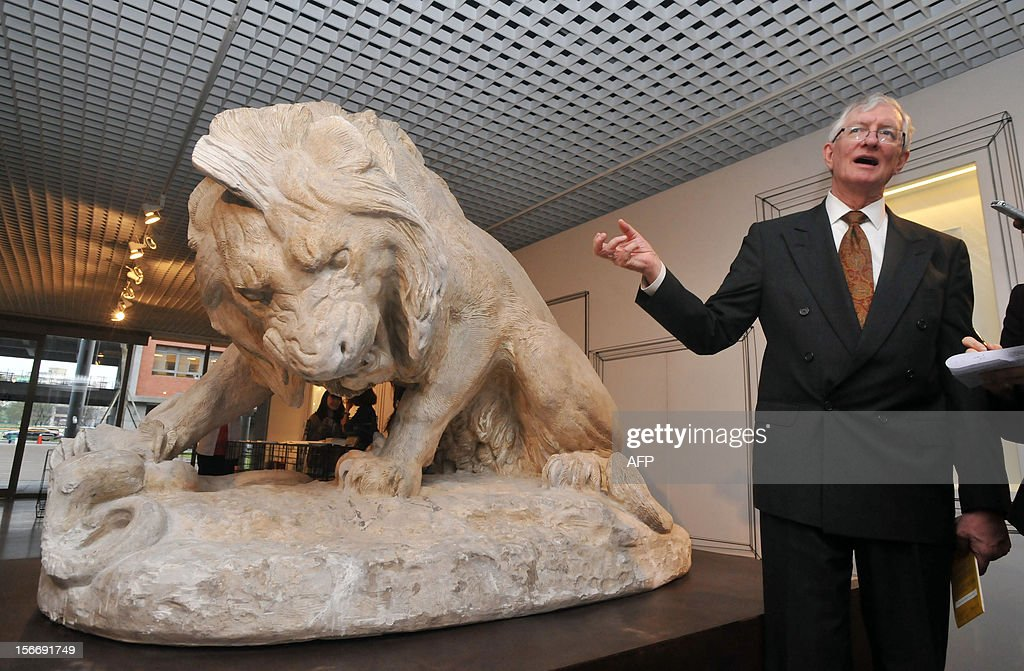 Metropolitan Museum of Art curator of the department of medieval art, Charles Little, introduces a bronze sculputre made by artist Antoine Louis Barye and named 'Lion Crushing a Serpent', from the Musee du Louvre in Paris, France during a press conference in Taipei on November 19, 2012. The Metropolitan Museum of Art first time selected the Taiwan Museum or Educational Institutions to gift a collection of 100 medieval plaster statues. AFP PHOTO / Mandy CHENG