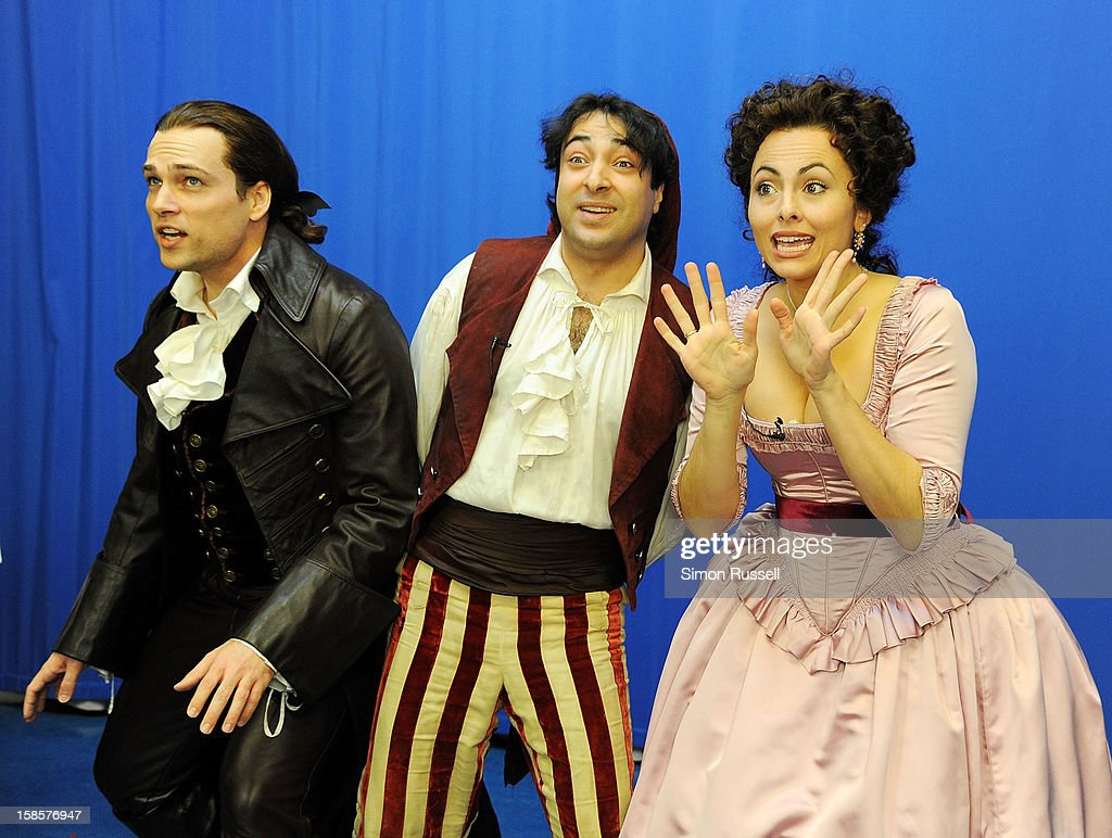 Metropolitan Opera stars Alek Shrader, Rodion Pogossov and Isabel Leonard perform 'The Barber Of Seville' at the Kravis Children's Hospital at Mount Sinai Medical Center on December 19, 2012 in New York City.