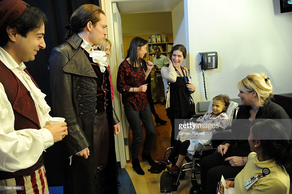 Metropolitan Opera stars Rodion Pogossov, Alek Shrader, Carol Torchen, Clinical Dir. of Women and Children Services at Mt. Sinai Hospital and patient Catherine Lamb (in wheelchair) after performance of 'The Barber Of Seville' at the Kravis Children's Hospital at Mount Sinai Medical Center on December 19, 2012 in New York City.