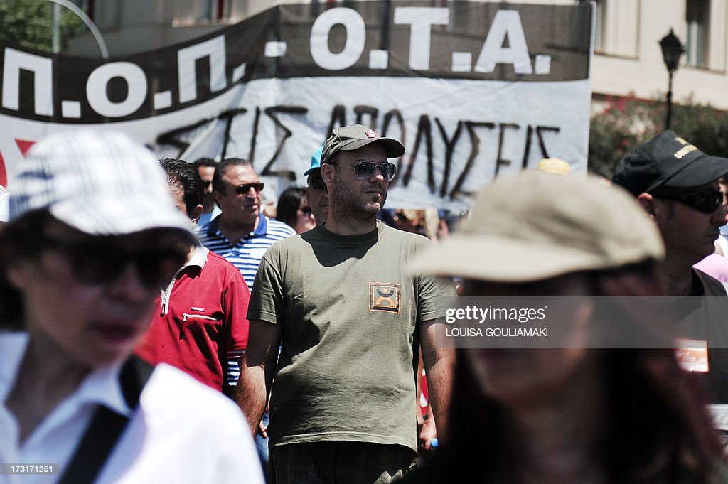Metropolitan police agents attend a demonstration near the Greek parliament in Athens on July 9, 2013, on the second consecutive day of strike, protesting against job cuts enacted by the government in return for promised EU-IMF rescue loans.