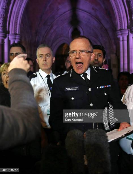 Metropolitan Police Assistant Commissioner Mark Rowley speaks to reporters outside The Royal Courts of Justice on January 8 2014 in London England An...