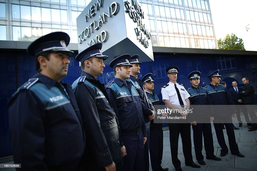 Metropolitan Police Commander Steve Rodhouse stands with Romanian and Polish police at Scotland Yard on October 24 2013 in London England Eight...