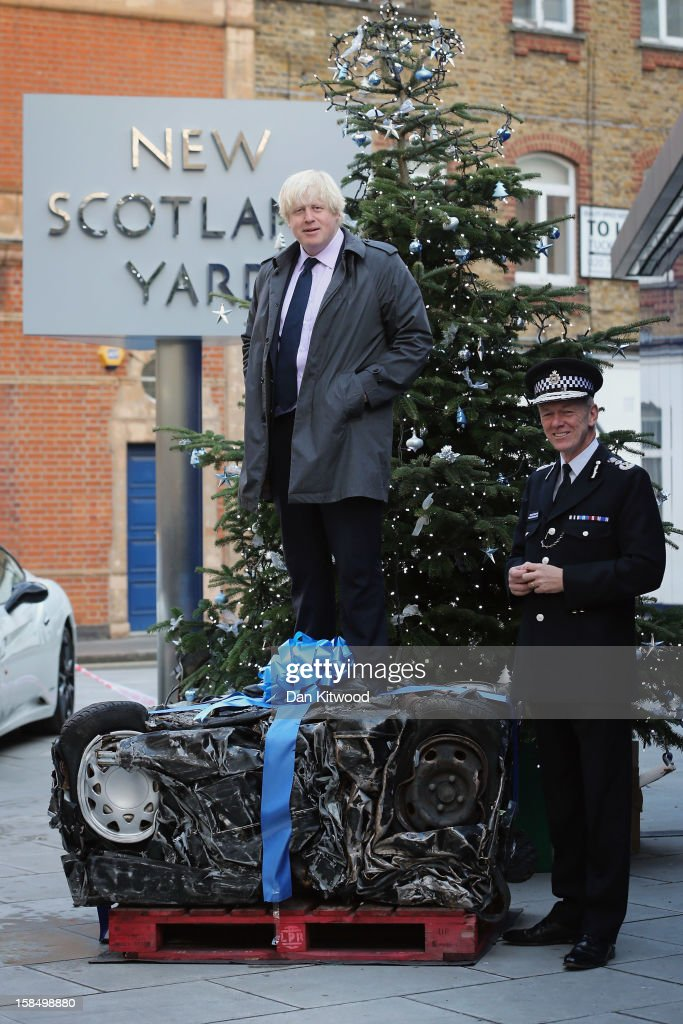 Metropolitan Police Commissioner Bernard Hogan-Howe (R) and the Mayor of London <a gi-track='captionPersonalityLinkClicked' href=/galleries/search?phrase=Boris+Johnson&family=editorial&specificpeople=209016 ng-click='$event.stopPropagation()'>Boris Johnson</a> pose next to a crushed car outside New Scotland Yard on December 18, 2012 in London, England. The photocall was designed to send a message to drivers illegally using London's roads over the Christmas period. The photocall coincides with 'Operation Cubo,' a day involving 1250 police officers in a co-ordinated series of operations targeting illegal drivers across the Capital.