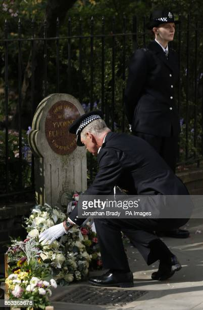 Metropolitan Police Commissioner Sir Bernard HoganHowe places a floral tribute during a memorial service held in St James Square London to mark the...
