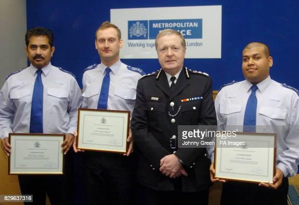 Metropolitan Police Commissioner Sir Ian Blair poses with PCSO's Stephen Richards Abdus Salaam and Dalit Hardayal