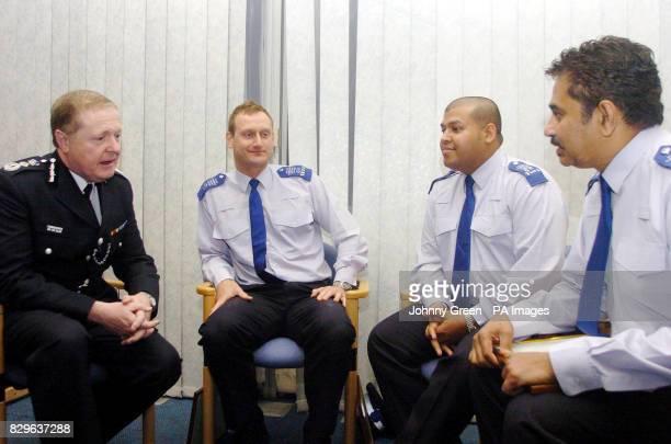 Metropolitan Police Commissioner Sir Ian Blair talks to PCSO's Stephen Richards Abdus Salaam and Dalit Hardayal