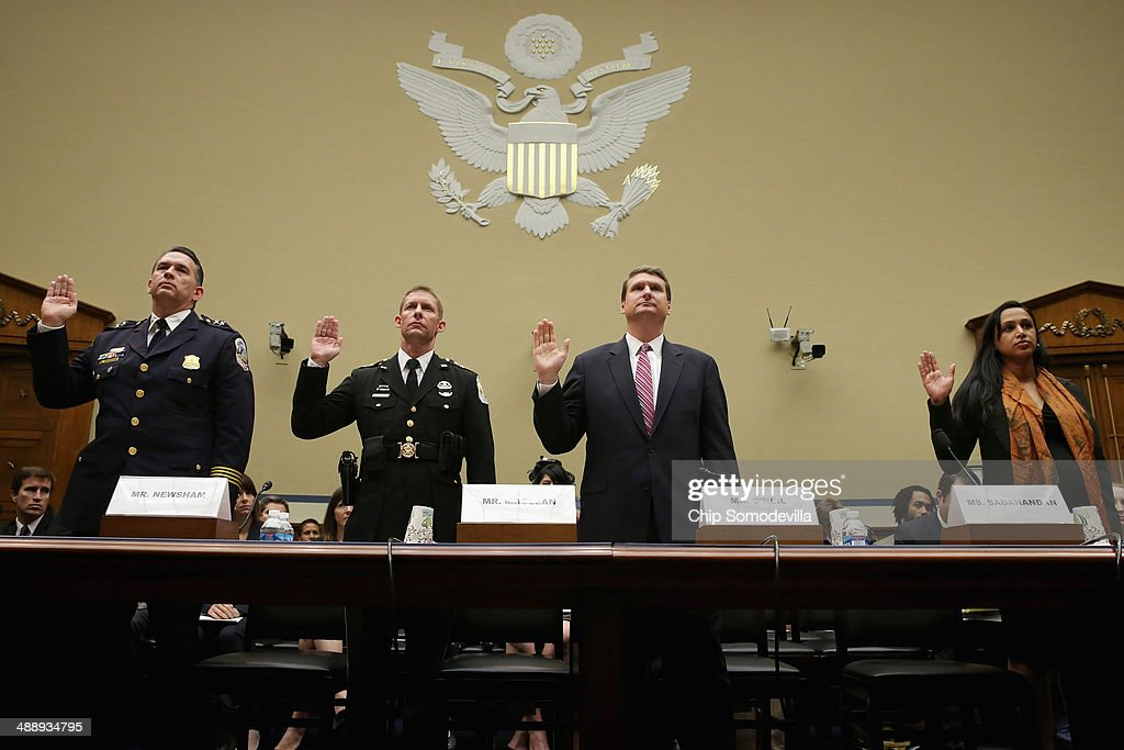 Metropolitan Police Department Assistant Chief Peter Newsham, United States Park Police Acting Chief Robert MacLean, Justice Department Criminal Division Acting Assistant Attorney General David O'Neil and American Civil Liberties Union Program Director Seema Sadanandan are sworn in before the House Oversight and Government Reform Subcommittee on Government Operations in the Rayburn House Office Building May 9, 2014 in Washington, DC. Norton and other witnesses testified about the federal government's enforcement of marijuana laws in the face of the district's efforts to decriminalize possession of the drug.