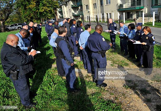 Metropolitan Police Department officers during roll call in the 2300 block of Ainger Place SE as part of All Hands on Deck on October 21 2011 in...