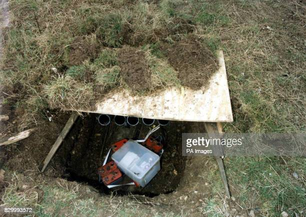 Metropolitan Police issued photograph of the Heathrow mortar launcher dug into a pit and covered over by grass near Bedfont Road on the south side of...