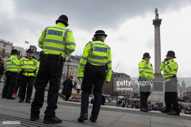 Metropolitan police offers stand on patrol in Trafalgar Square during raised security presence after the terrorist attack at Westminster in central...