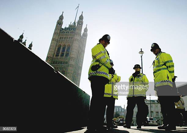 Metropolitan police officer patrols the streets of Westminster March 2 2004 in London The government today announced figures showing that police...