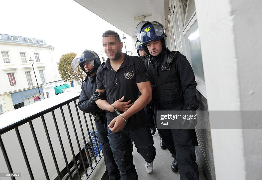 Metropolitan Police officers arrest a man suspected of ...