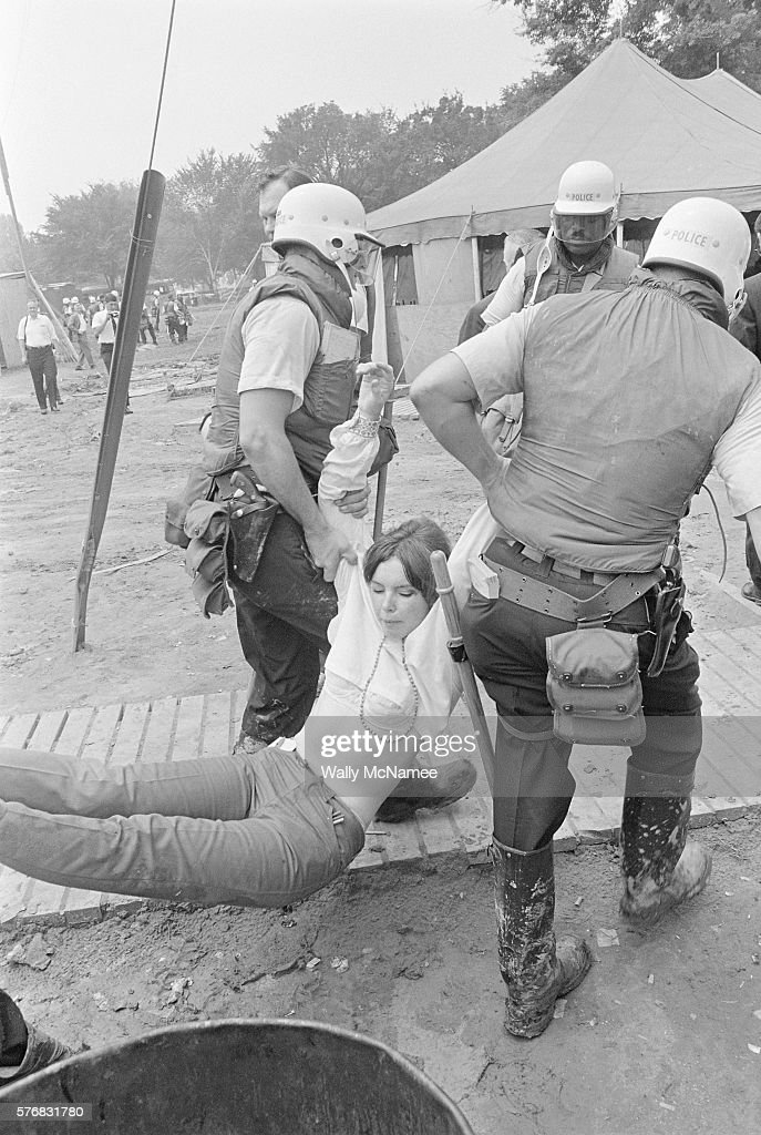 Metropolitan police officers carry an unwilling demonstrator from the grounds of Resurrection City The shantytown used as a staging ground for...