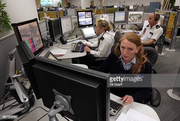 Metropolitan Police officers view displays from CCTV cameras around London in the Special Operations Room of their Central Communications Command...
