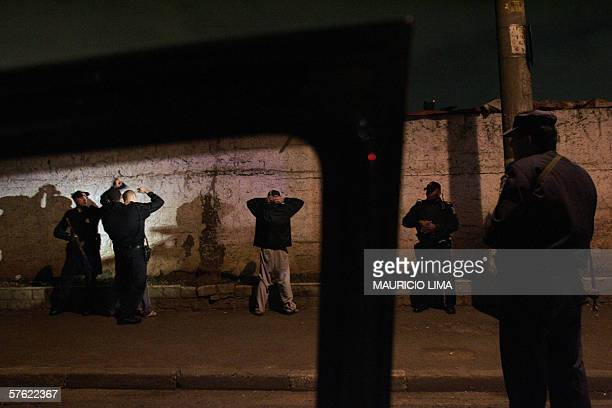 Metropolitan policemen frisk youths suspects during a large night security check launched by local police in downtown Sao Paulo Brazil early 16 May...
