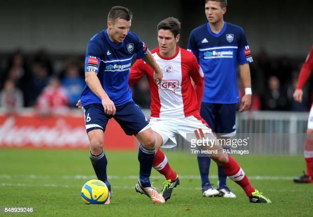 Metropolitan Police's Matt Smart and Crawley Town's Josh Simpson during the FA Cup First Round match at the Metropolitan Police Sports Club East...