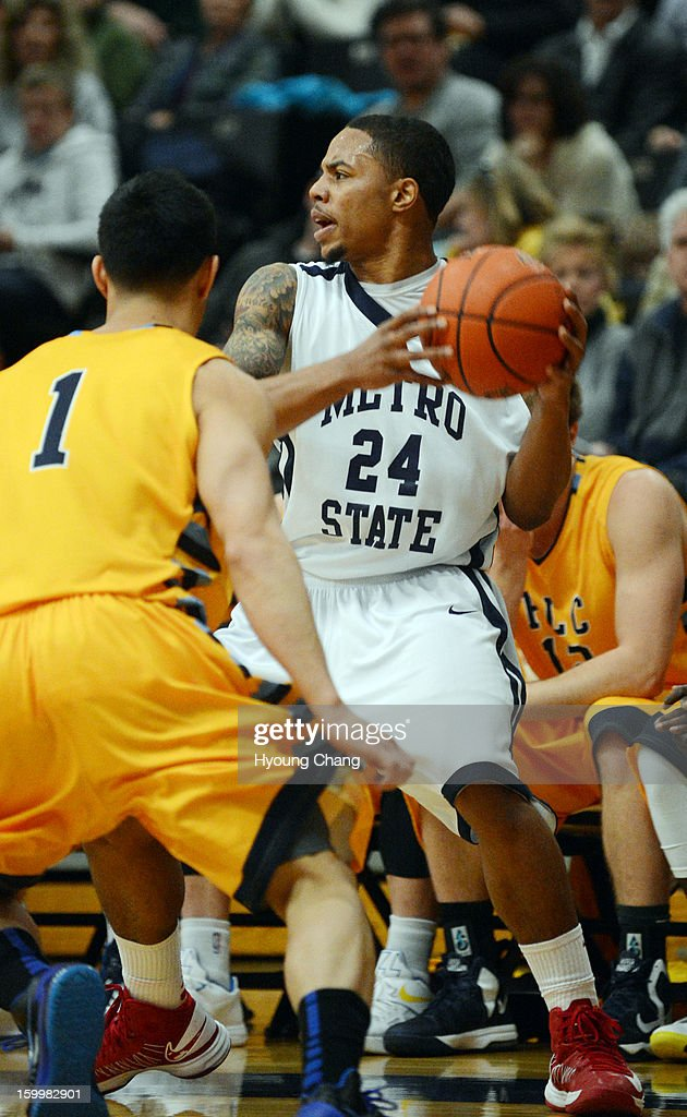 Metropolitan State University of Denver men's basketball team Demetrius Miller, right, is trying to pass the ball to a teammate under the pressure of Fort Lewis College Matthew Mazarei during the 1st half of the game at Auraria Event Center.